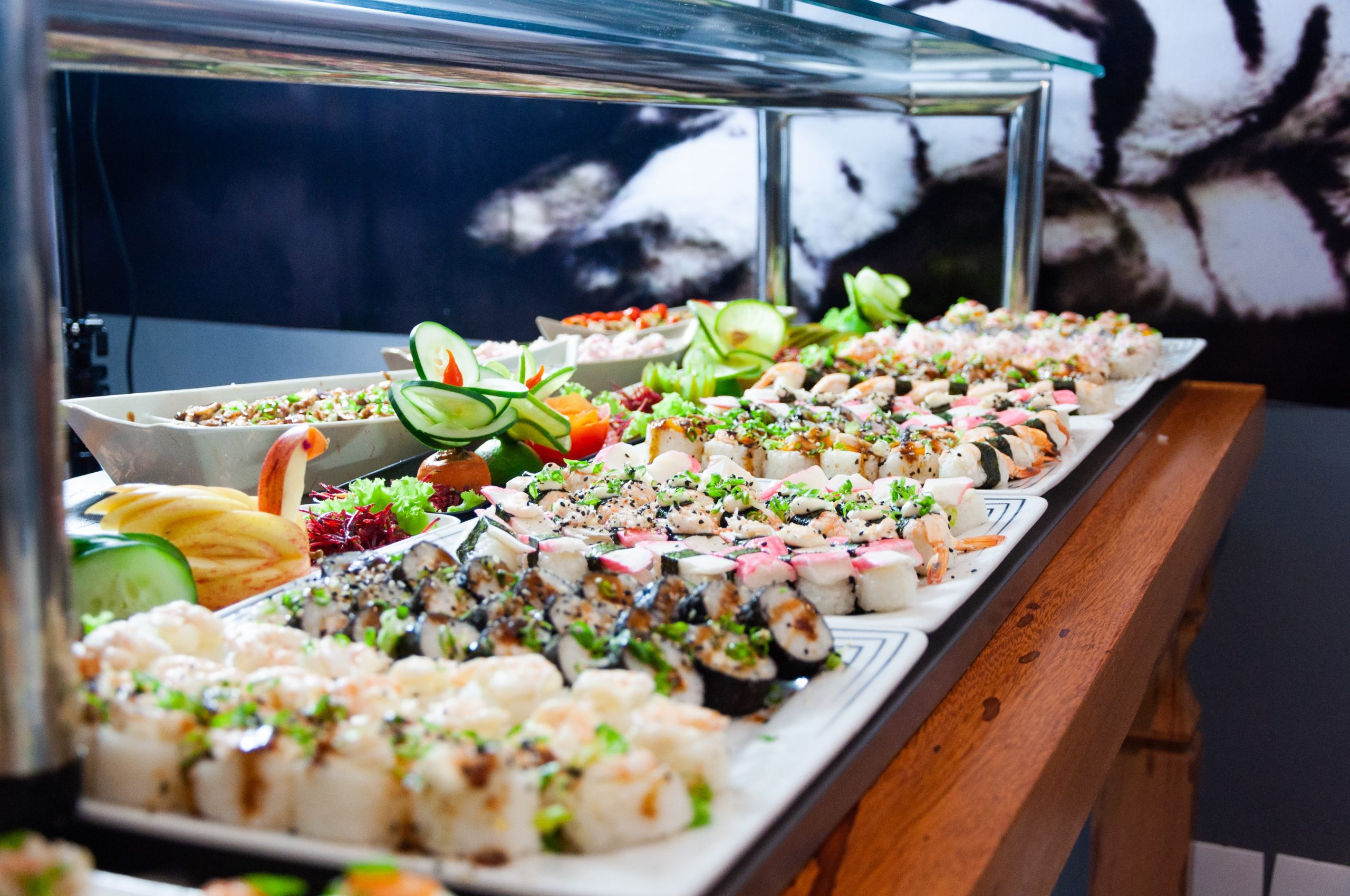 sushi-on-white-plates-on-brown-wooden-table-2264036